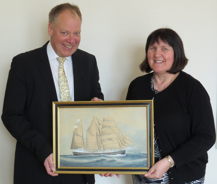 Humber Bondholders chairman and shipbroker Peter Aarosin gives his Reuben Chappell watercolour to Goole Civic Society Chair Margaret Hicks-Clarke