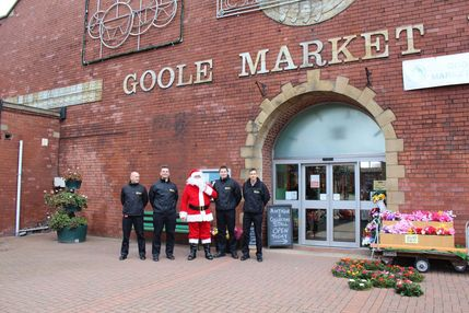 Santa arrives at Goole Market flanked by firemen