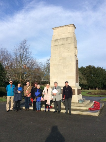 Goole volunteers survey the town's cenotaph as part of a Civic Voice training workshop